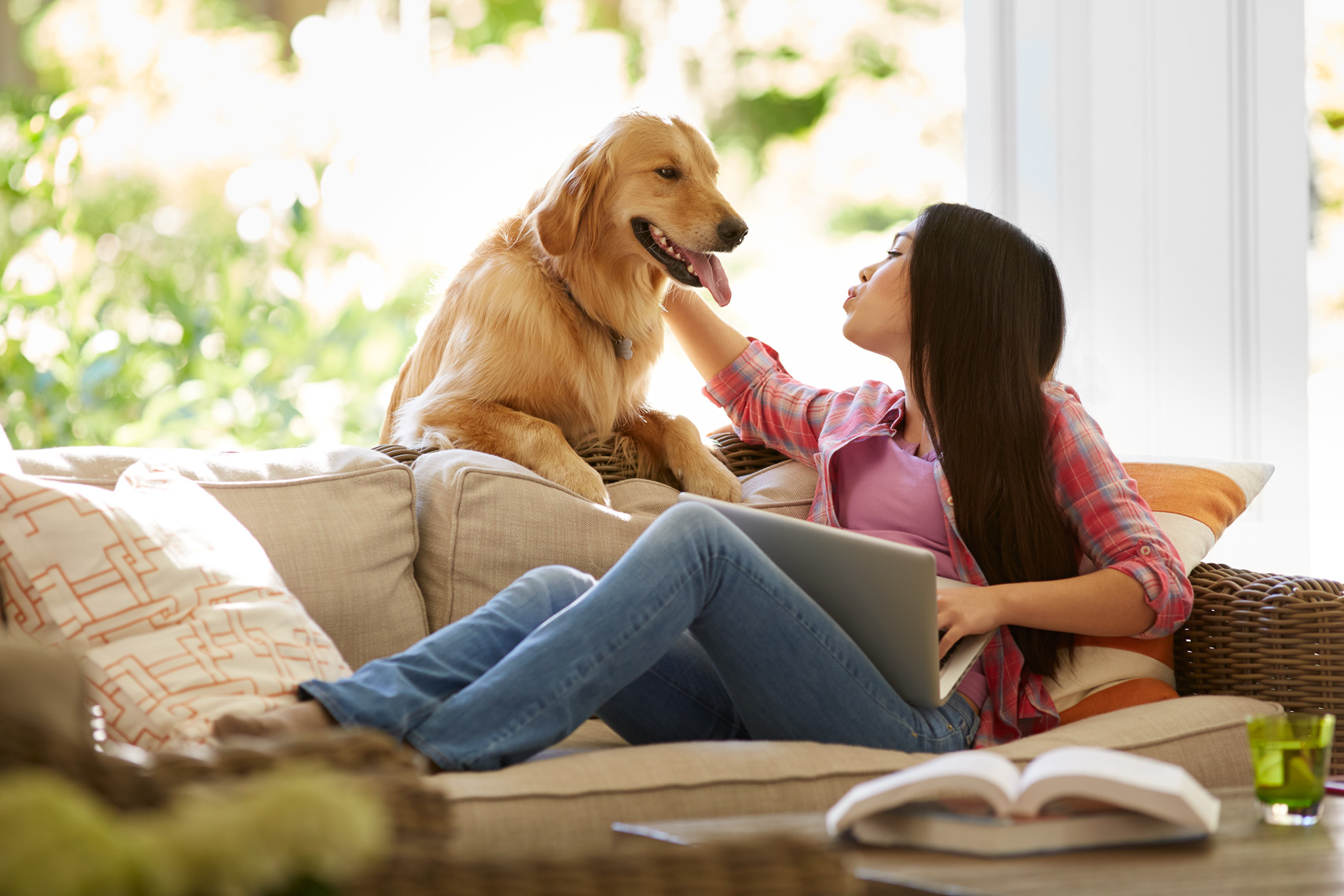lifestyle photographer, advertising photographer, girls,living room, couch, sofa, dog, playing with dog