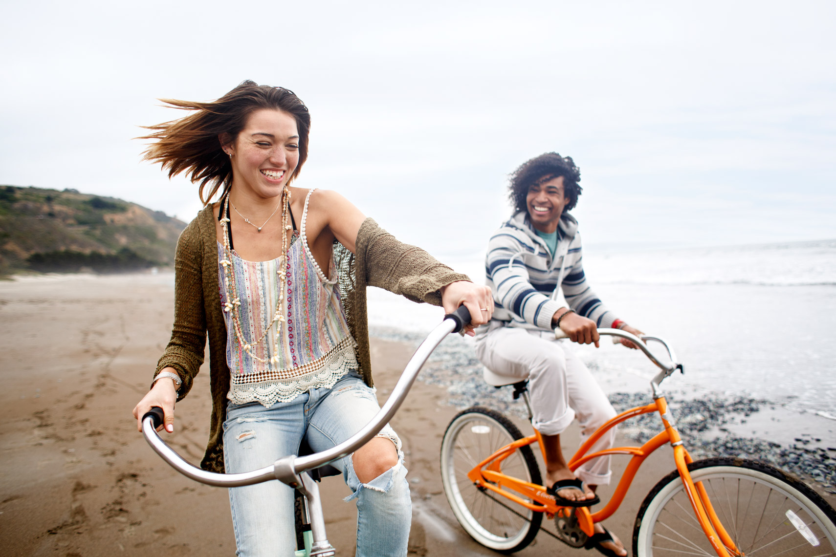 San Francisco Bay Area Advertising, Lifestyle, Commercial Photographer, african american female riding bikes on beach, millennials, girls riding bikes