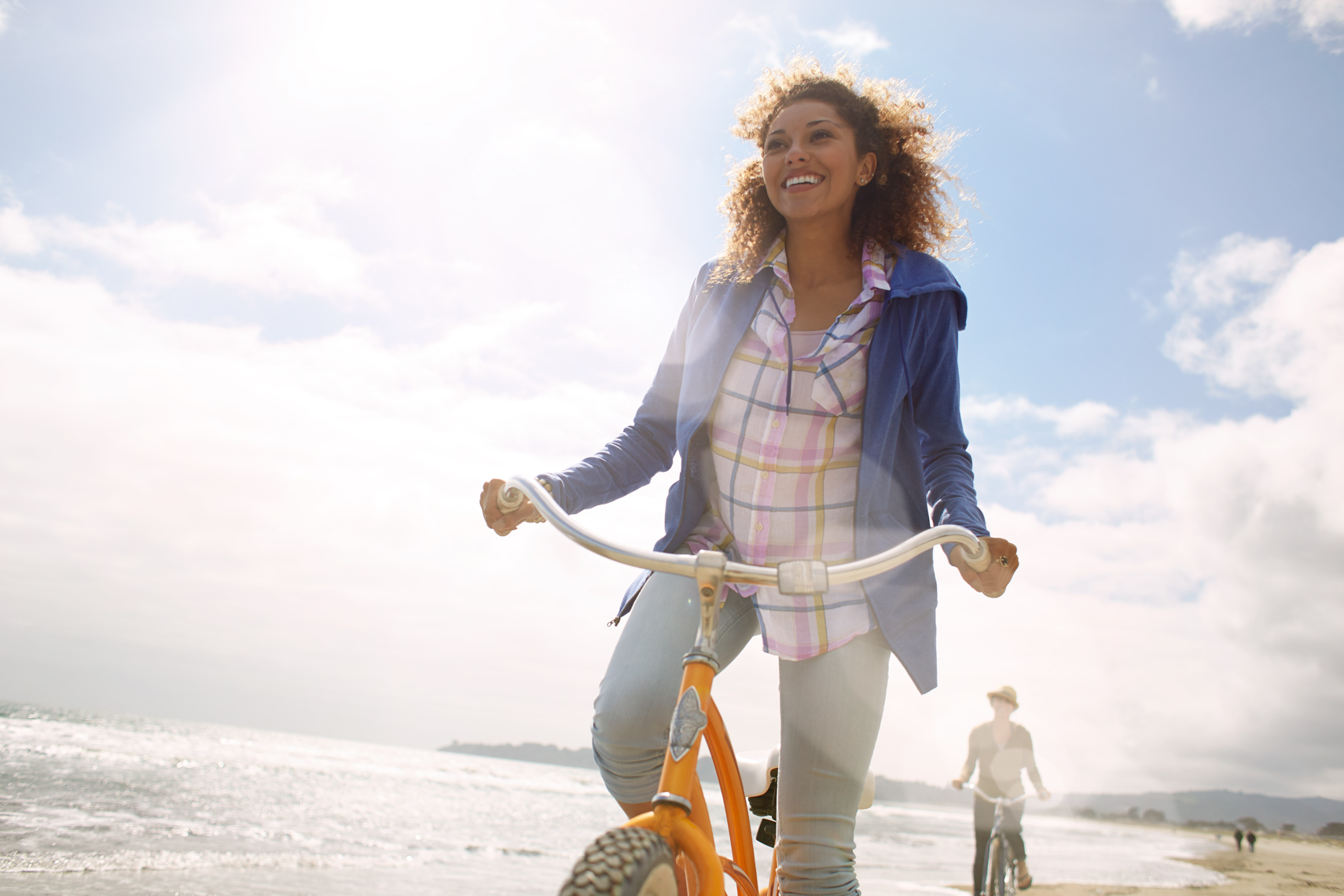 San Francisco Bay Area Advertising, Lifestyle, Commercial Photographer, african american female riding bike on beach, millenials