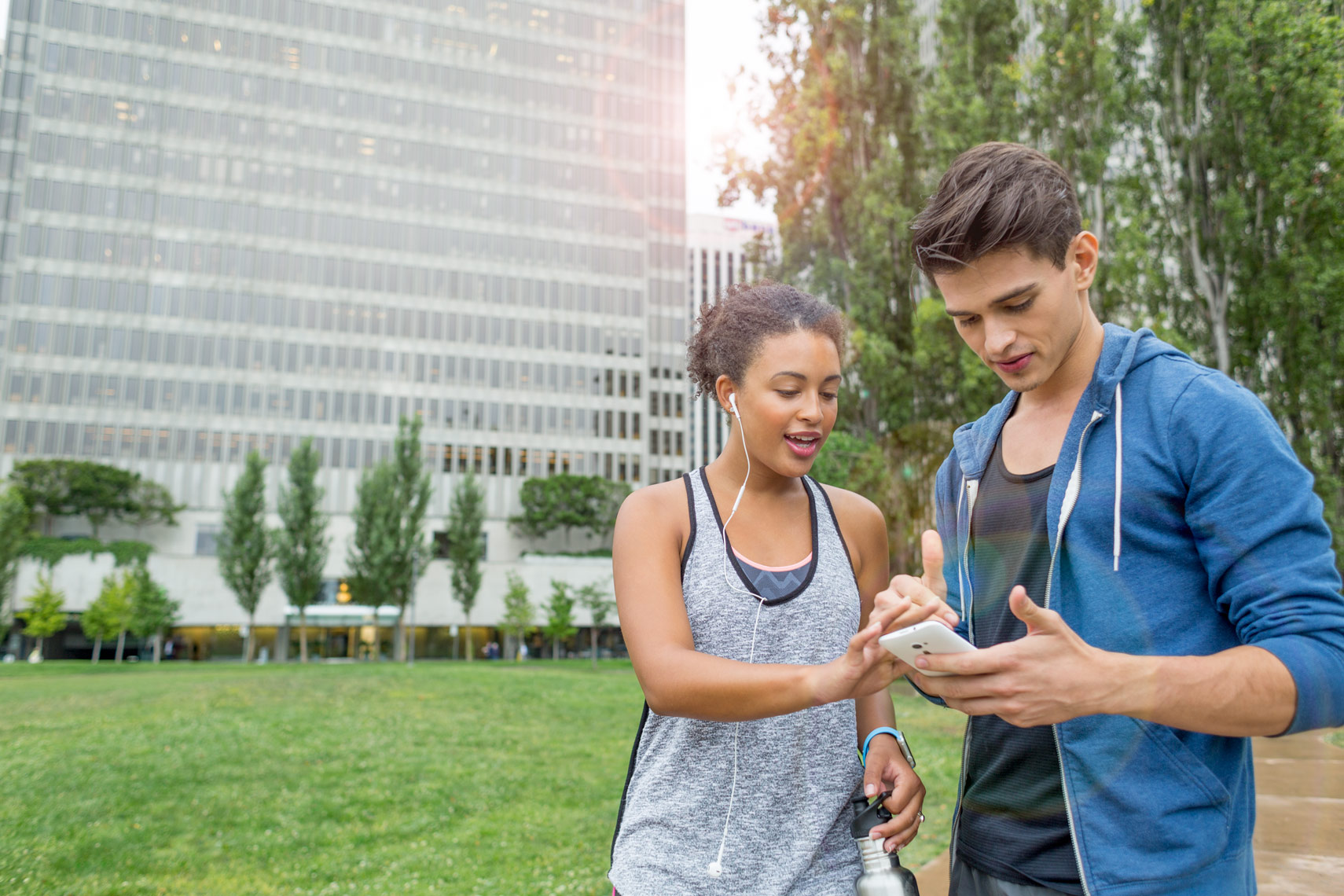 San Francisco Bay Area Advertising, Lifestyle, Commercial Photographer, college students on campus exercising and checking phones, smiling, a young couple running outdoor talking to each other, millennials