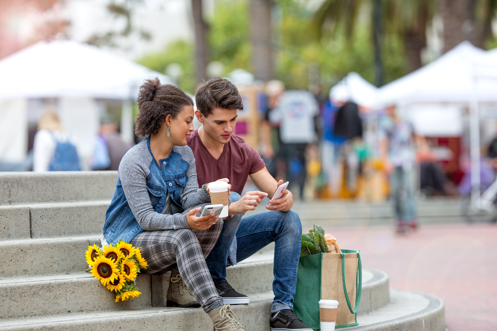 San Francisco Bay Area Advertising, Lifestyle, Commercial Photographer, Students on campus sitting on steps checking phones, smiling, a young couple sitting outdoor, millennials