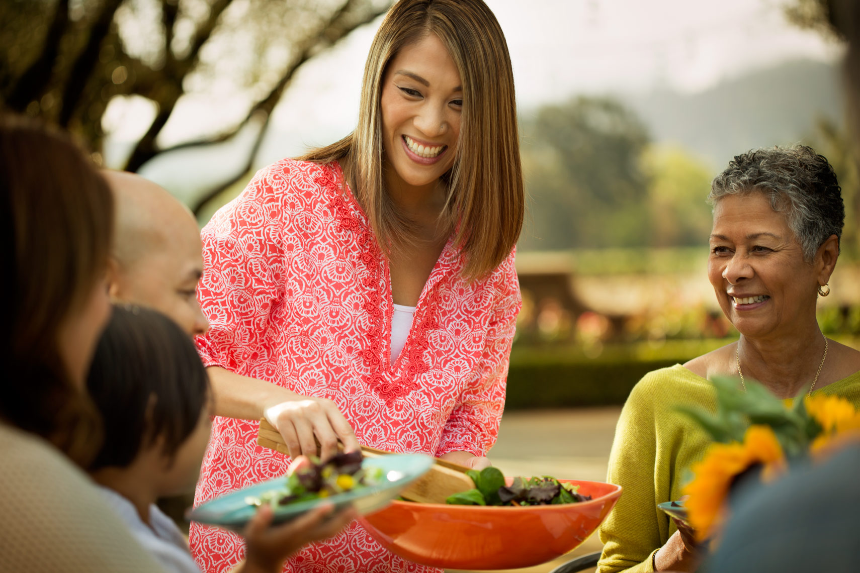 San Francisco Bay Area Advertising, Lifestyle, Commercial Photographer, African american family dinning outdoor in the backyard garden, women smiling, family gathering, multi racial family